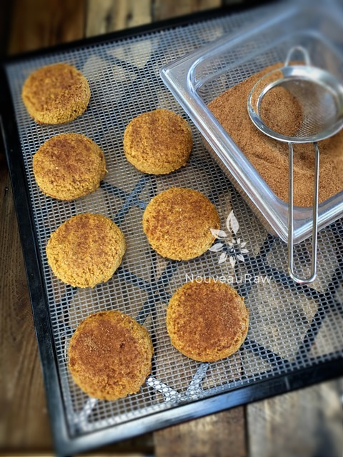 sprinkling coconut crystals over an over view raw vegan gluten free of Soft Brown Sugar Ginger Cookies
