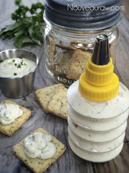 raw vegan Herbed Cashew Cheese in a  squeeze bottle