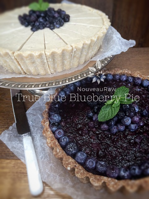 raw blueberry pie display with a raw blueberry cheese cake