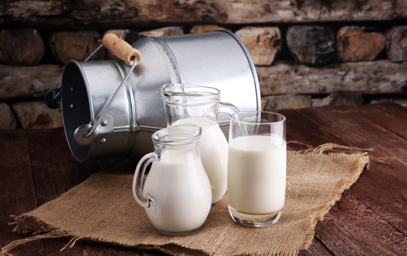 almond-milk with a tin jug