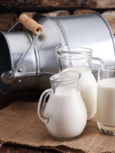 homemade almond milk in pretty glass pitchers