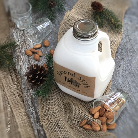 a jug of fresh raw almond milk