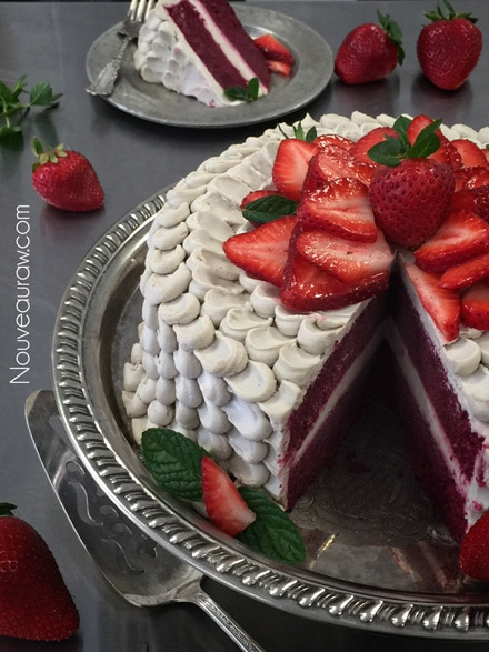 Yummy Smooth Raw vegan Red Velvet Cake topped with fresh strawberries