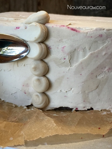 Use the tip of a very small spoon to drag the frosting out