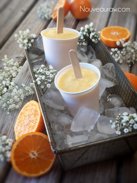 close up raw vegan Orange Julius Creamsicle Lollies in Dixie cups