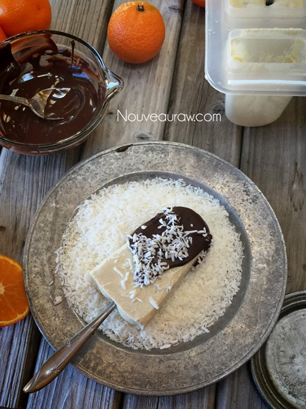raw vegan Orange Julius Creamsicle Lollies dipped in chocolate and shredded coconut