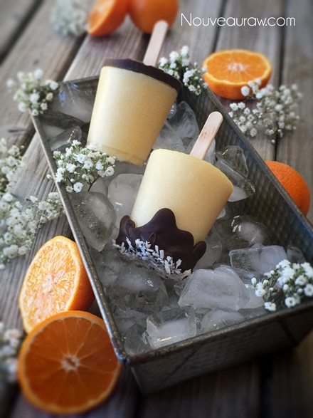close up raw vegan Orange Julius Creamsicle Lollies in Dixie cups and ready to be served