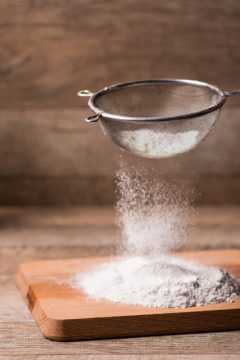 tiger-nut-flour shaking through a sifter