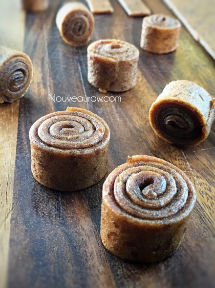 Tightly roll each strip into coils, repeat until done - Raw Rollo Date Caramels