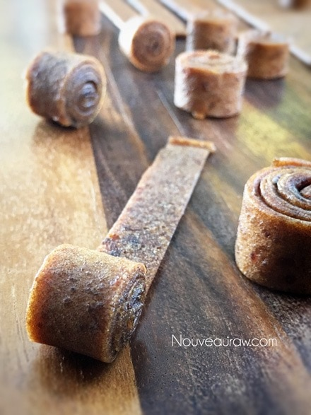 Tightly roll each strip into coils - Raw Rollo Date Caramels
