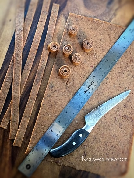 """Cut the date leather cut into 1"""" strips - Raw Rollo Date Caramels"""
