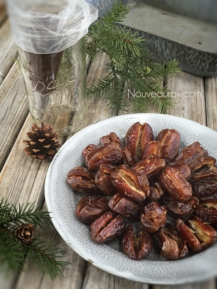 a dish full of sliced open Medjool dates - Recipe for raw Caramel Ganache Truffles