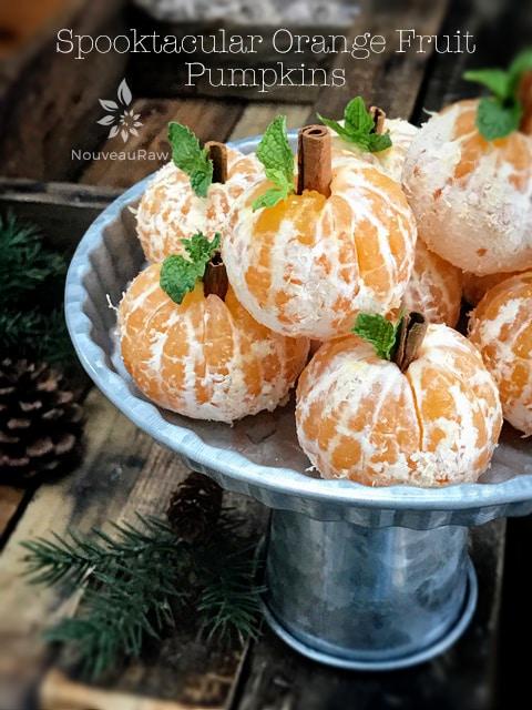 Spooktacular Orange Fruit Pumpkins displayed on a silver tray for Halloween