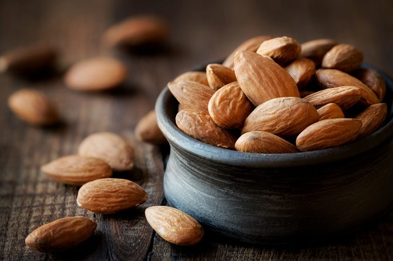 almonds in a black bowl