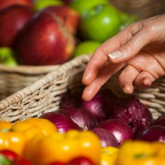 hand reaching to select fresh produce