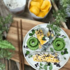 vegan Coconut Jicama Rice and Jackfruit Wraps served with avocado flowers