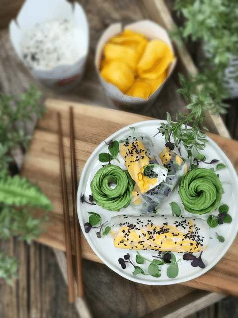 Coconut-Jicama-Rice-and-Jackfruit-Wraps served with avocado flowers